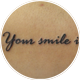 筆記体「Your smile is」